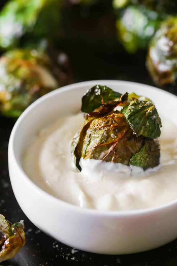 on the stalk roasted brussels sprouts dipped in garlic mayonnaise