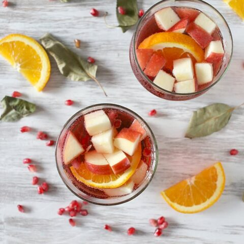 This simple Thanksgiving sangria is packed full of pomegranate seeds, apple, orange and semi sweet red wine. This drink is perfect for your holiday table.