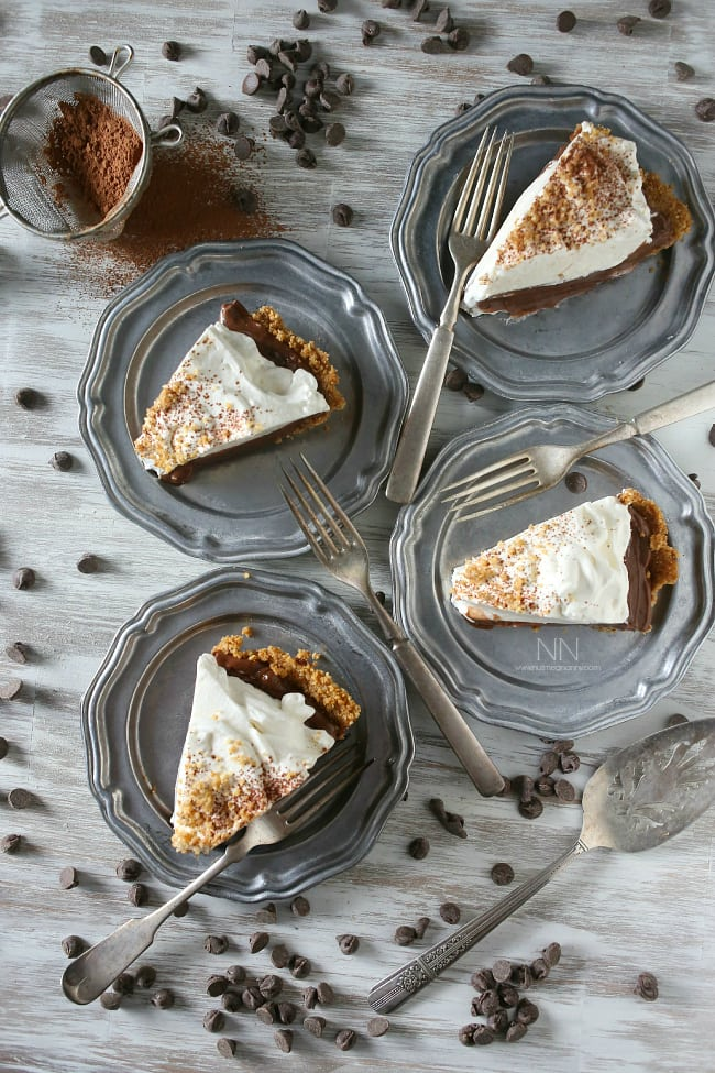 This super simple chocolate orange pudding pie is a breeze to make! Crazy delicious chocolate orange pudding packed into a pretzel crust. It's the perfect sweet and salty bite!