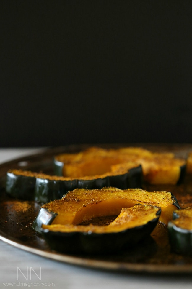 This simple curry roasted acorn squash is the perfect easy Thanksgiving side dish. Packed full of flavor and ready in under 30 minutes!