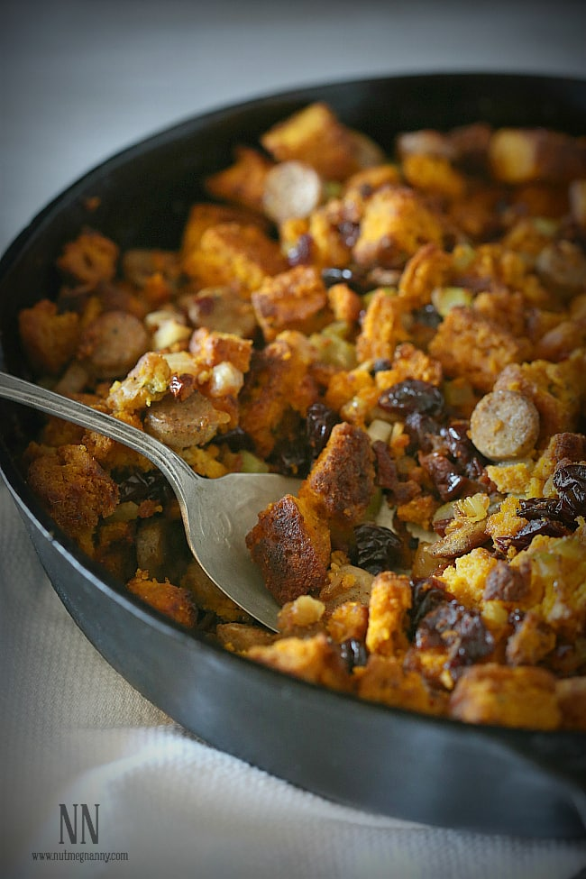 This pumpkin cornbread chicken sausage stuffing is packed full of homemade pumpkin sage cornbread croutons, chicken sausage and dried cherries. Perfect for Thanksgiving!