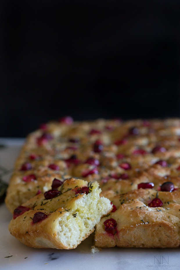 This cranberry rosemary focaccia is easily made from a fresh yeast dough and topped with lots of chopped rosemary, fresh tart cranberries and a sprinkling of kosher salt.