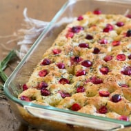 This cranberry rosemary focaccia is easily made from a fresh yeast dough and topped with lots of chopped rosemary, fresh tart cranberries and sprinkling of kosher salt.