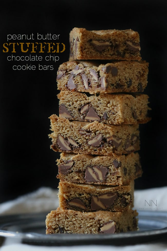 These peanut butter stuffed chocolate chip cookie bars are  bursting with lots of peanut butter deliciousness. Serve warm with a big glass of cold milk.