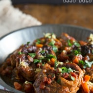 This homemade veal osso buco is the perfect holiday meal. Made with tomatoes, fresh herbs and a touch of white wine.