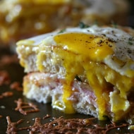 This croque madame is the perfect combination of bechamel cheese sauce, Canadian bacon and Swiss cheese stuffed between two slices of crusty bread. Perfect for breakfast or dinner.