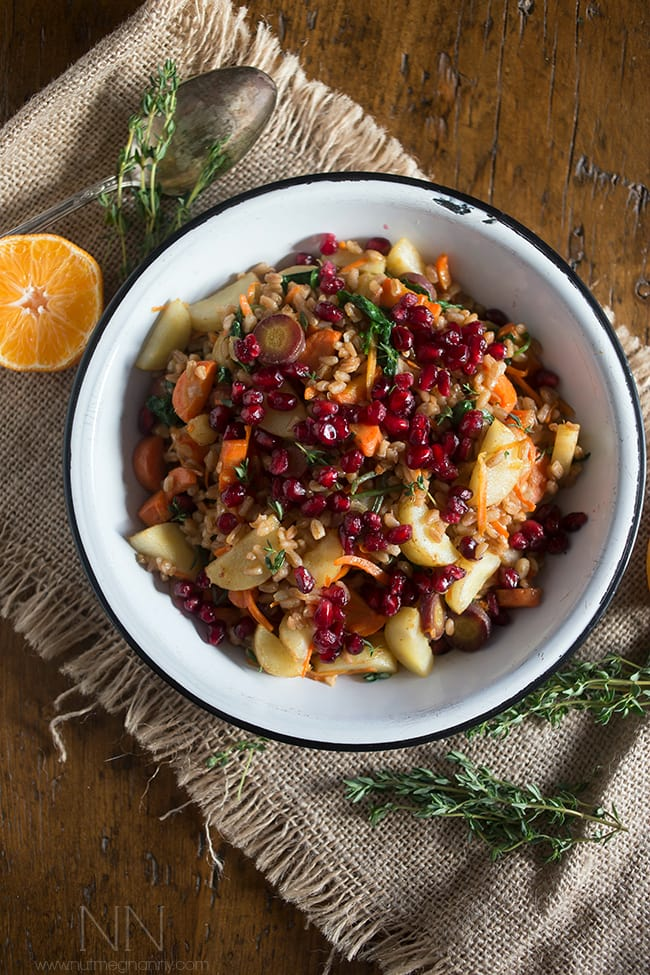 This farro carrot pomegranate salad is the perfect healthy side dish. It's packed full of vegetables and dressed with a simple squeeze of orange.