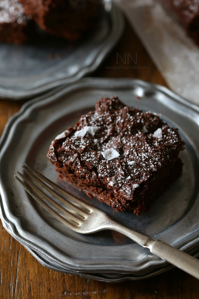These dark chocolate yogurt brownies are packed full of rich chocolate flavor and a hint of tangy yogurt flavor. Top with flaked sea salt and powdered sugar.