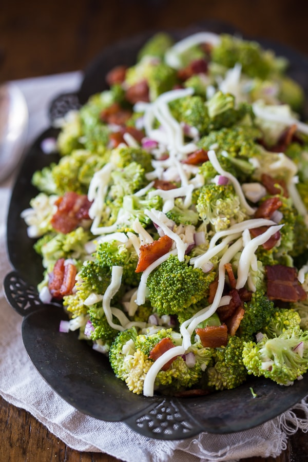 This tangy broccoli bacon salad is creamy, crunchy and packed full of flavor. A delicious mixture of broccoli, bacon, red onion, mozzarella cheese and creamy homemade dressing. Say hello to your new favorite salad!