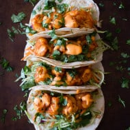 These chipotle shrimp tacos are the perfect balance of sweet and spicy. Flour tortillas topped with tangy broccoli slaw, chipotle shrimp and gochujang mayonnaise.