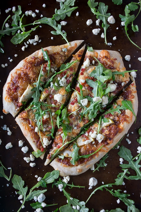 This apple butter blue cheese pancetta pizza is the perfect addition to your weeknight menu planning. It's sweet, savory and oh so delicious. Plus it's ready in just 30 minutes!