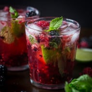 This sweet mixed berry mojito cocktail combines delicious fresh raspberries, blackberries, mint and rum. It's super delicious, perfect for spring and takes only 5 minutes to make!