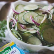 greek yogurt ranch cucumber salad in a bowl with a small packet of ranch seasoning on the side