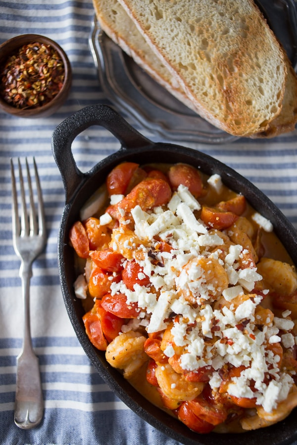 This skillet sherry shrimp and tomatoes is ready in under 30 minutes and packed full of spicy shrimp, feta cheese and cherry tomatoes. So easy and fresh! Serve over rice or couscous!
