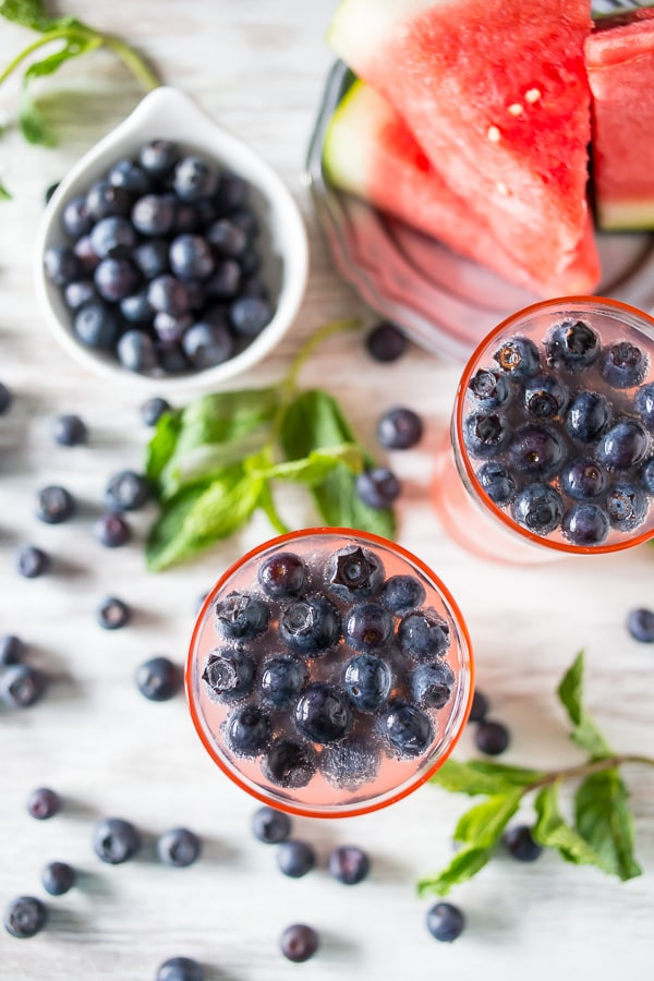 This watermelon blueberry mint spritzer is the perfect Memorial Day cocktail. Fruity watermelon mixed with fresh mint, blueberries and a touch of Truvia.