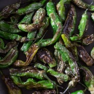 These blistered shishito peppers are the perfect summertime vegetable snack. Cooked quickly in oil and sprinkled with kosher salt for veggie perfection.