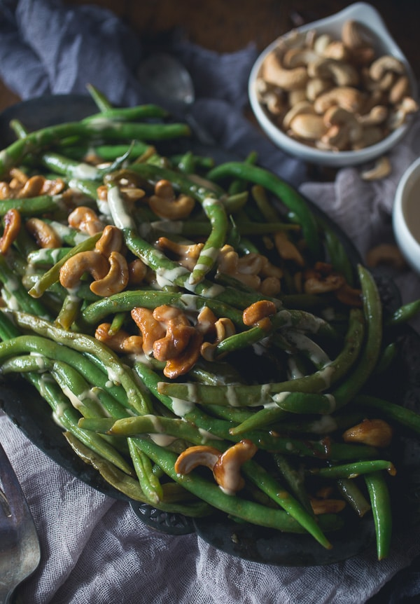 These Girl and the Goat Magic Beans taste just like beans you can get in the Chicago restaurant. Perfectly crisp, flavorful and ready in no time. Flavored with fish sauce vinaigrette and sautéed with crunchy cashews.