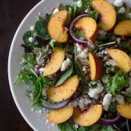 This peach feta salad with peach vinaigrette is the perfect way to celebrate summer. Baby greens, fresh peaches, feta, red onion, praline pecans and perfectly sweet peach puree vinaigrette.