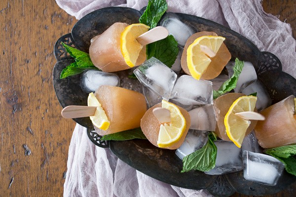 These sweet tea popsicles are the perfect way to enjoy summer. I froze up Southern sweet tea flavored with lemon and mint to create the perfect hot summer day treat.
