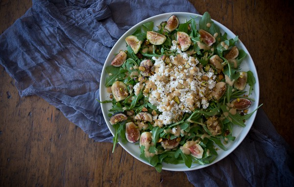 This fig goat cheese salad with fig vinaigrette is the perfect late summer salad. Packed full of fresh figs, goat cheese, pistachios and a homemade fig vinaigrette.