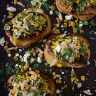 This open face bbq chicken burger with peach corn salsa is the perfect summer burger. Deliciously spiced with the perfect balance of sweet and savory. Ground chicken mixed with smoked paprika, chili powder and bbq sauce all cooked up to perfection, served on Texas toast and topped with sweet and savory peach corn salsa, cotija cheese and crispy fried onions. You'll have a hard time not wanting to eat this burger all summer long!