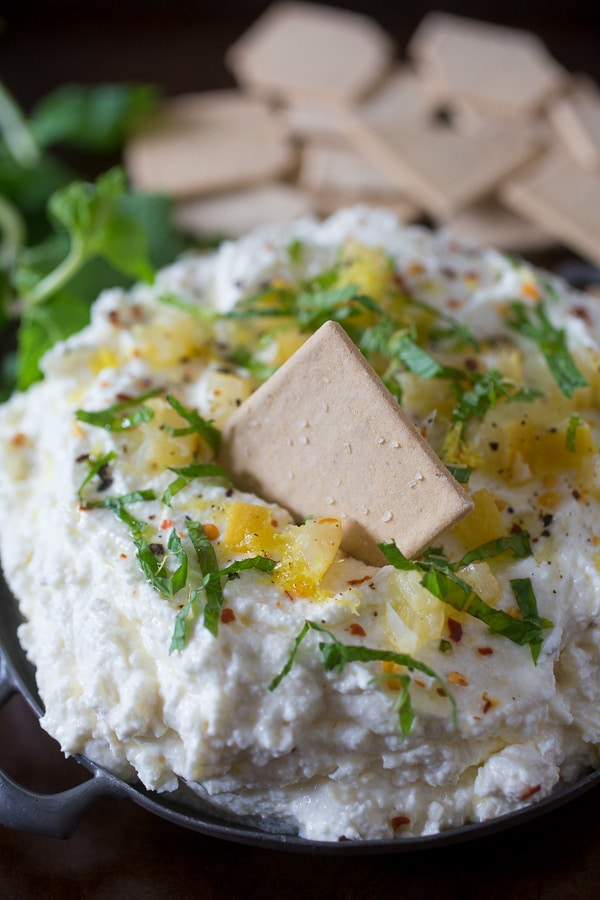 This preserved lemon and mint whipped feta dip is so easy to make you'll be making is all summer long. Ready in just 10 minutes and can be scooped up with crackers, vegetables or by the spoonful!