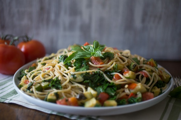 This zucchini tomato kale pasta packs all the flavors of summer into one pasta dish. Simple to throw together and ready in under 30 minutes!