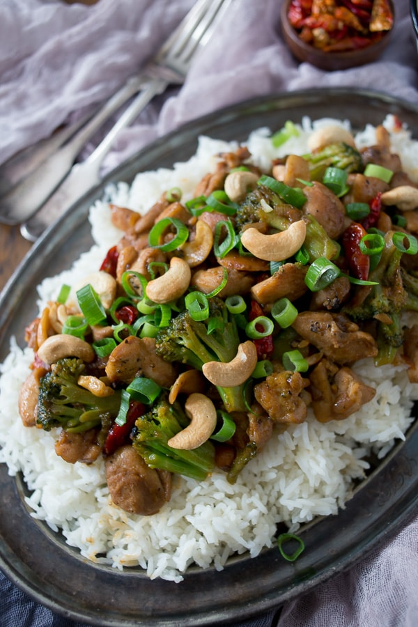This spicy cashew chicken is better than take out. Made with delicious fresh ingredients and ready in just 30 minutes. It's fake out take out and it's delicious!