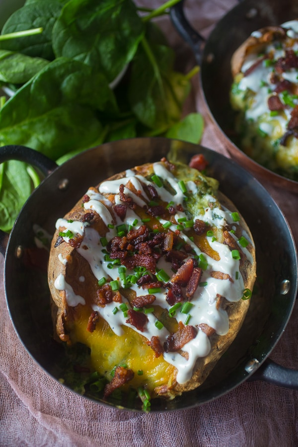 These spinach bacon ranch twice baked potatoes are packed full of flavor and made with a secret ingredients - Greek yogurt ranch dip. So delicious and PACKED full of flavor. They make a great side dish or a main course.