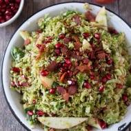 This shaved Brussels sprouts apple bacon salad is the perfect combo of sweet, salty and savory. Super easy to make and drizzled with a maple vinaigrette.