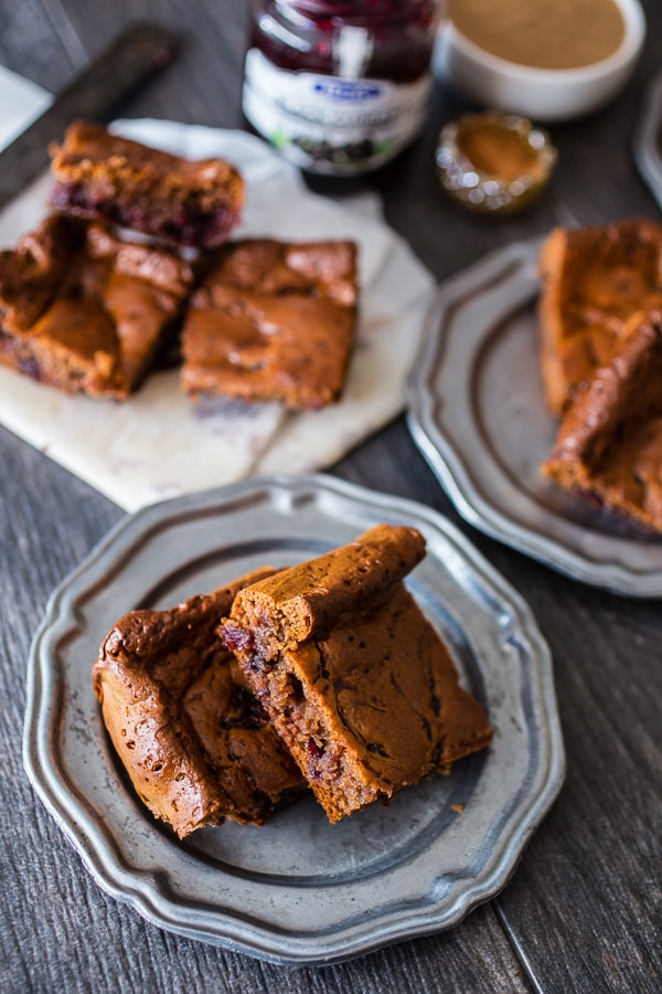 These paleo gingerbread blondies are packed full of holiday flavor. 100% Paleo made with almond butter, honey, warm spices and black currant jam.