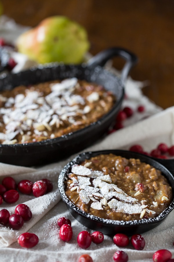 These cranberry pear baked steel cut oats are the perfect way to welcome the day. Full of delicious winter fruit flavor and hearty enough to keep you full for hours. Top with toasted nuts and a sprinkling of powdered sugar to jazz it up.
