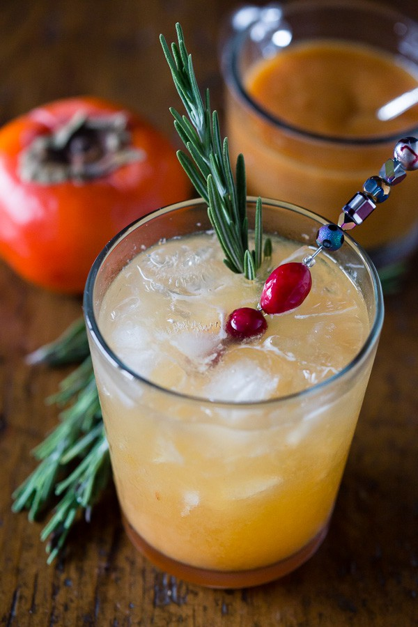 This persimmon old fashioned cocktail is a tasty winter libation. Made with a sweet persimmon puree, rye and just a touch of seltzer. So easy to make and drink!