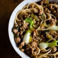 This spicy pork noodle bowl is packed full of flavor and ready in just 20 minutes. It's a quick and easy meal that is sure to please you whole family! Spicy ground pork sautéed with Sichuan peppercorns and swimming in a delicious broth with baby bok choy and perfectly cooked noodles.