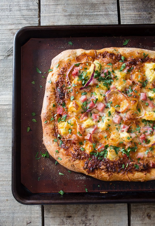 This bbq Hawaiian pizza is the perfect use for all that leftover ham. Tangy bbq sauce topped with melted cheese, red onions, pineapple and ham. You'll love how easy this is to throw together PLUS it's ready in just 25 minutes!