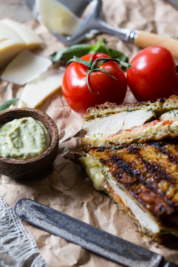 This grilled chicken pesto panini is a quick and easy weeknight meal. Made with grilled marinated chicken, sharp provolone cheese, pesto mayonnaise and ripe tomatoes. You'll love this sandwich so much you'll want to make it every single week!