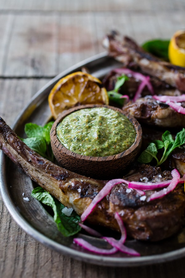 These grilled lamb chops with pistachio mint pesto are a fun way to jazz up your Easter dinner. The whole dish is ready in just 20 minutes and is packed full of springtime flavor. Lightly seasoned lamb drizzled with a homemade pesto that is sure to impress even your pickiest of eaters.