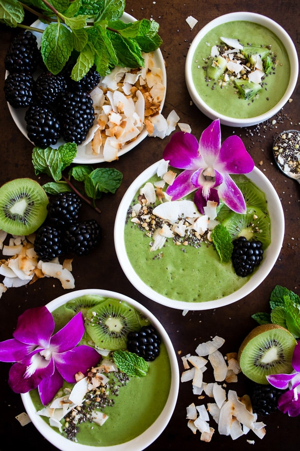 This tropical smoothie bowl is made with frozen bananas, mango, spinach, chia seeds, vanilla soy yogurt and coconut milk. It's ready in just 5 minutes and tastes like a tropical paradise.