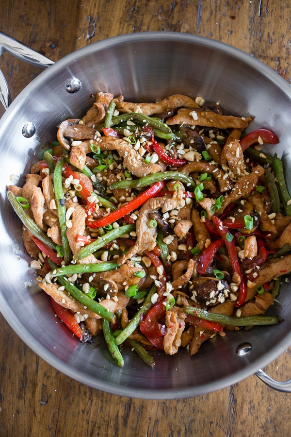 This spicy garlic pork stir fry is the perfect weeknight takeout fakeout! Why order random stir fry when you can make your own super flavorful dish at home? Plus it's ready in just 35 minutes! This stir fry is slightly spicy, full of garlic flavor and packed with marinated pork, mushrooms, red bell pepper and crispy steamed green beans.