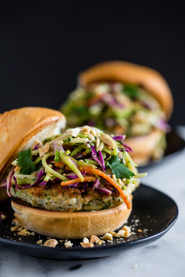 These Thai chicken burgers are packed full of fresh herbs and topped with a crunchy vegetable slaw tossed with a peanut butter dressing. Ready in about 30 minutes and LOADED with flavor!