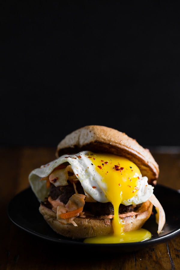 This kimchi burger is topped with a fried egg and TONS of kimchi. You'll love all the flavor that is PACKED into these burgers! Say goodbye to boring burgers.