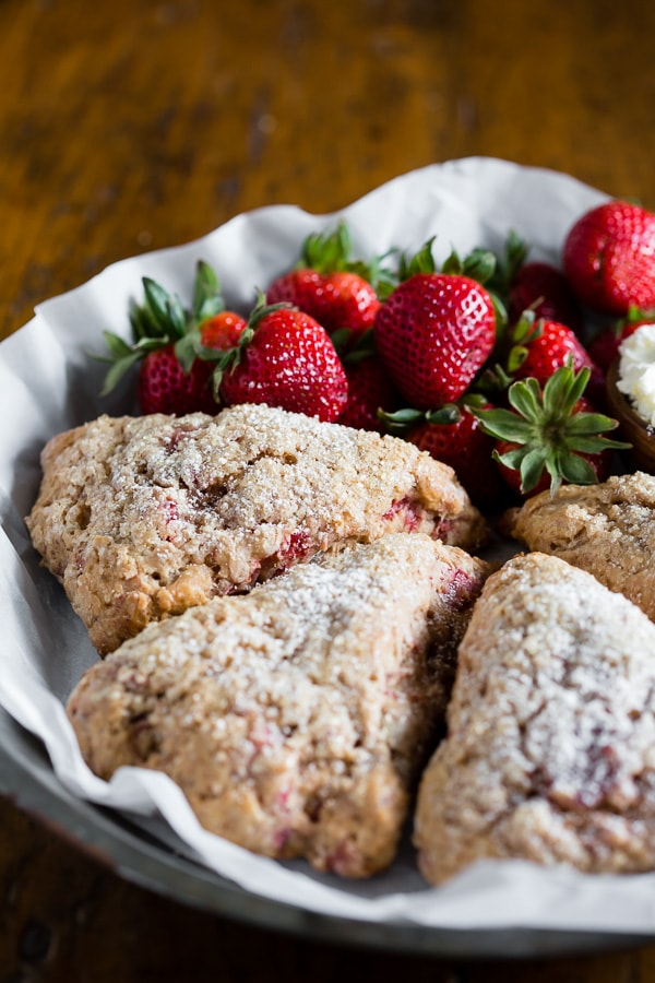 These roasted strawberry Greek yogurt scones are packed full of fresh roasted berries, vanilla Greek yogurt and made with white whole wheat flour! So easy to make and perfect for a lazy Sunday breakfast treat.