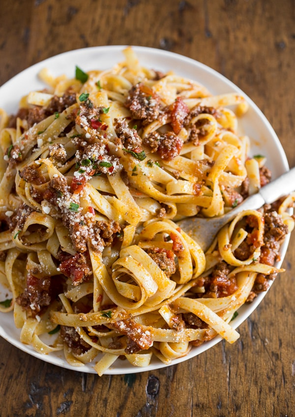 This slow cooker Parmesan meat sauce is slow cooked and full of flavor. Perfectly seasoned and goes great over fresh pasta. It can be easily frozen so you can have fresh sauce any day of the year!