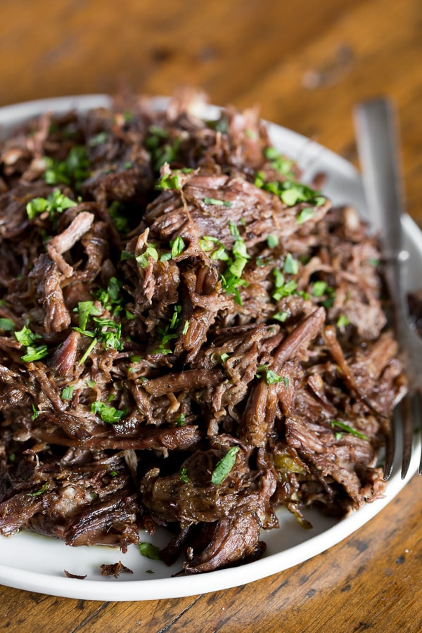 This homemade Mississippi roast is made in the slow cooker and packs some big flavor. Serve over egg noodles, mashed potatoes or even piled high on a bun. Plus this version is 100% homemade so it uses ingredients easily found in your pantry and no flavor packets!