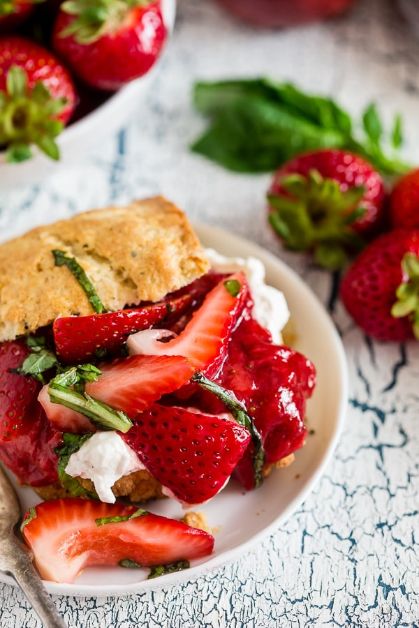 This strawberry basil shortcake is the perfect summertime dessert. Tender shortcake biscuits topped with homemade strawberry jam, macerated berries with basil and fresh whipped cream. So easy and delicious you'll want to make it all summer long.