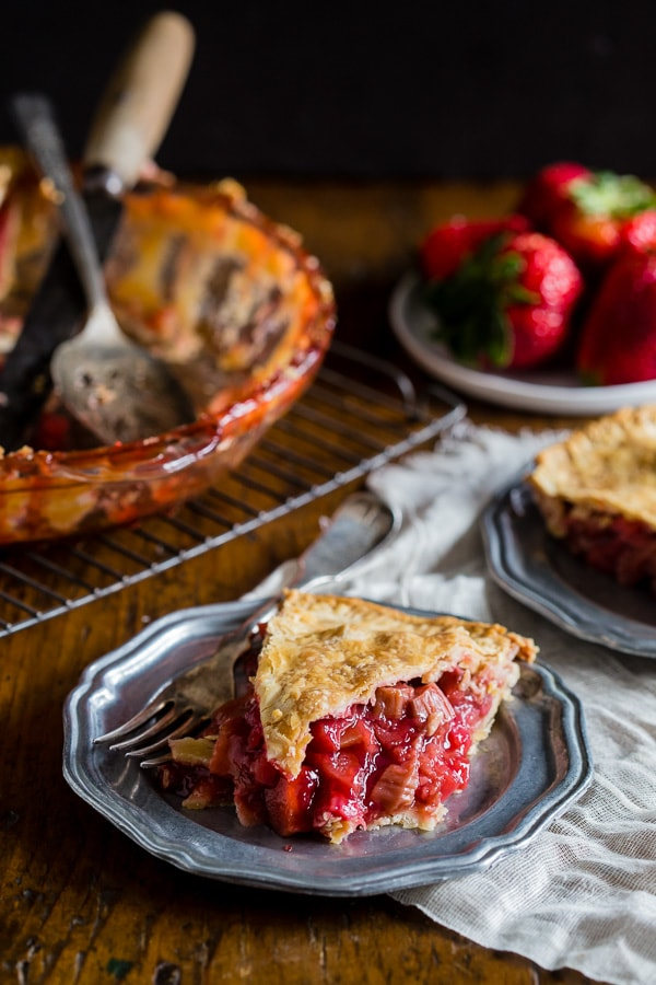 This homemade strawberry rhubarb pie is the quintessential summer pie. Filled with sun-ripened strawberries and tart rhubarb. Serve warm, room temperature or with a big giant scoop of ice cream.
