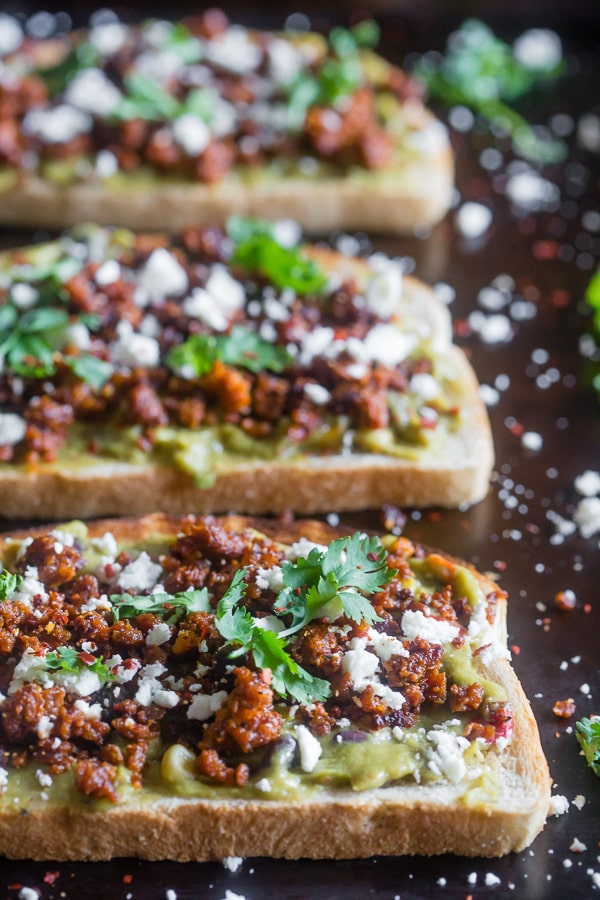 This chorizo cotija guacamole toast is a great way to start the day OR a delicious mid-day treat. Savory guacamole mixed with fresh vegetables and topped with spicy chorizo, salty cotija and a sprinkling of cilantro. You're going to go crazy over this delicious toast!