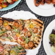 This grilled chicken sausage pizza is made 100% on the grill and is perfect for jazzing up your normal bbq routine. Topped with grilled chicken sausage, mushrooms, cherry tomatoes, mozzarella cheese and lots of fresh basil. You'll want to make this part of your summer as soon as possible!
