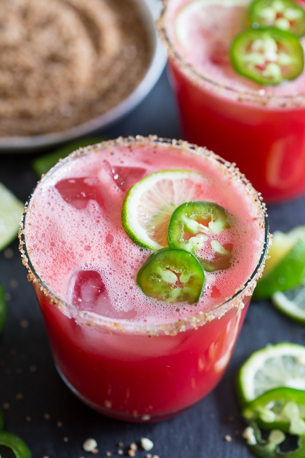 This jalapeno watermelon margarita is your new favorite margarita. The perfect balance of sweet and spicy and made with fresh pureed watermelon and spiked with jalapenos and just a splash of tequila, lime juice and orange liqueur. This is the spicy cocktail of your dreams.