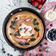 This vanilla bean dutch baby is PACKED full of vanilla beans and topped with lots of fresh summer berries. It's so easy to make and sure to impress your whole family. Plus, who doesn't love vanilla beans and berries?